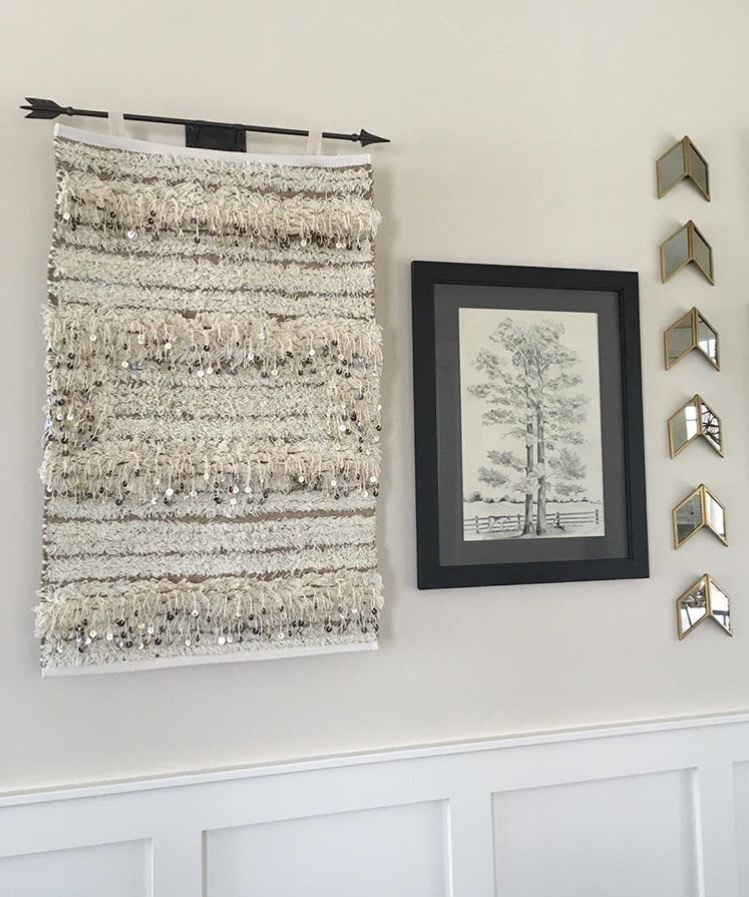 wall decor design with tapestry mirrors and photo frame