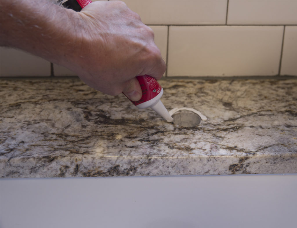 caulk-sink-faucet-fireclay-installation