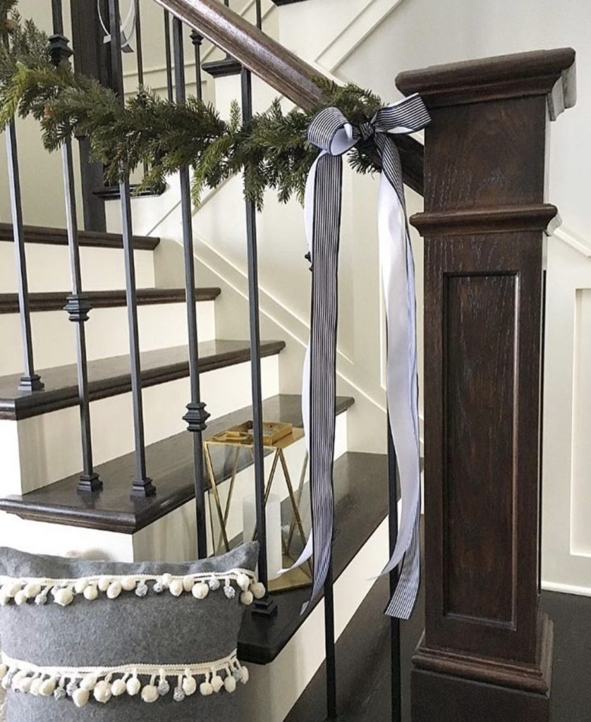 staircase wrapped with garland