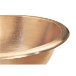 close-up of born vessel naked copper bathroom sink rim