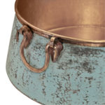 close-up of handles and verde exterior finish of nobel vessel copper sink