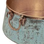 close-up of handles and verde exterior finish of nobel vessel copper sink