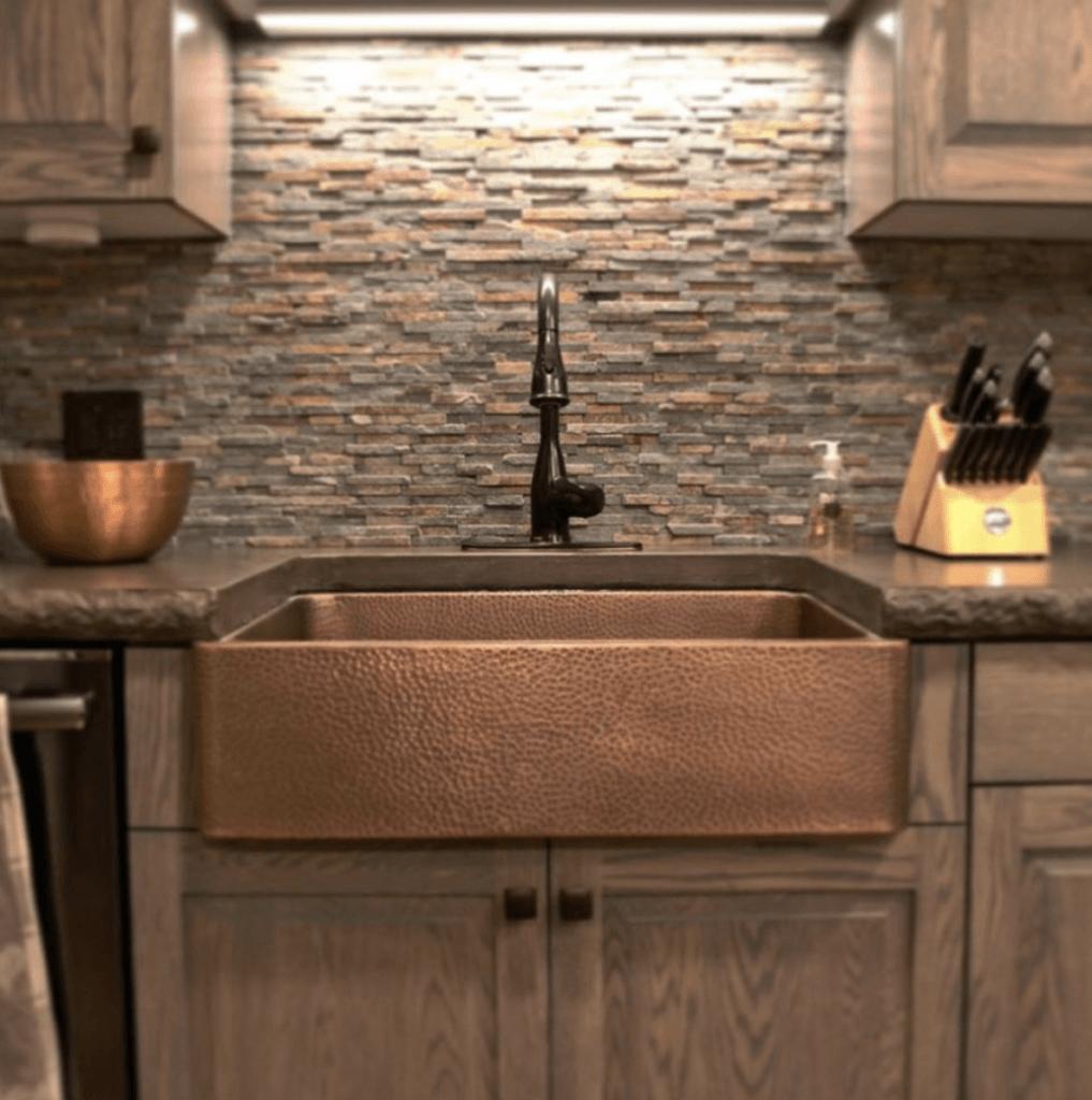 copper sink in dark kitchen