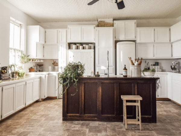 large white kitchen with vintage island