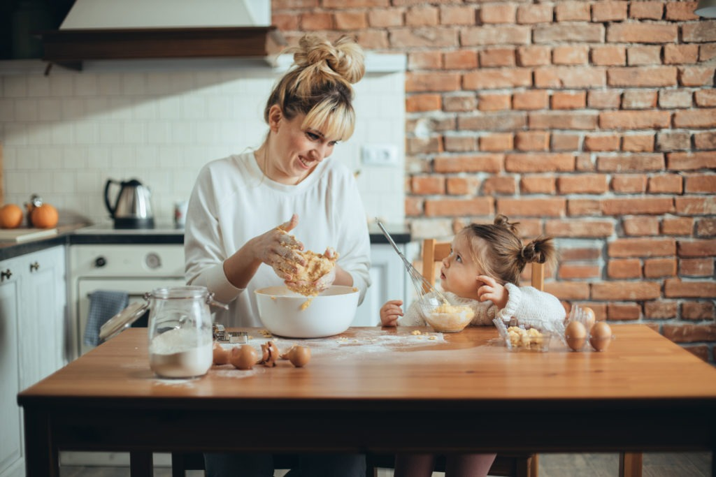mother and daughter making bread