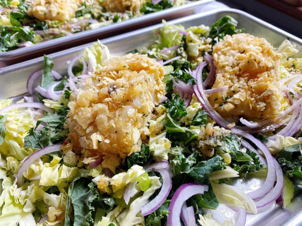 unbaked cod on veggies